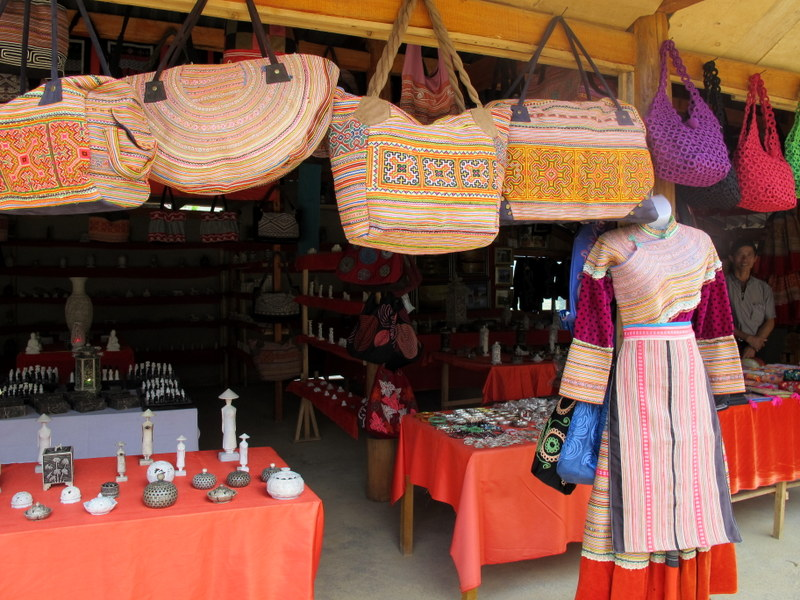 Traditional dress and cloth made into bags at a road side stall for tourists.