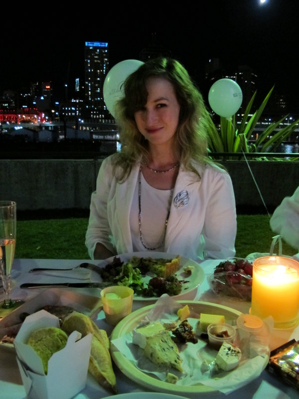 Looking rather happy and a little smug with the city lights behind me and  my candle-lit dinner in front of me