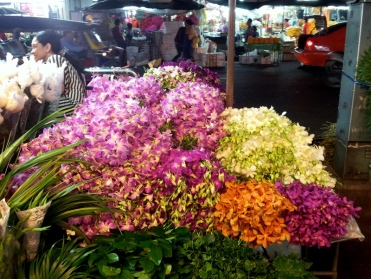 Piles of orchids in the Bangkok flower markets
