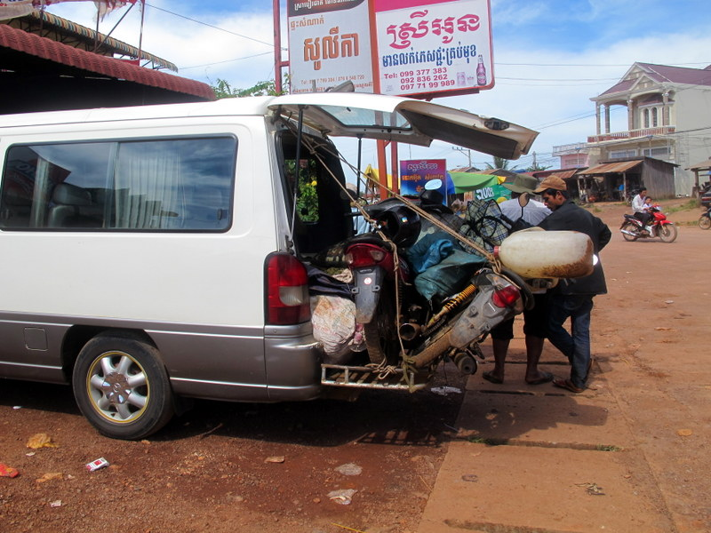 Cambodian cross-country transport. Not the most comfortable way to travel.