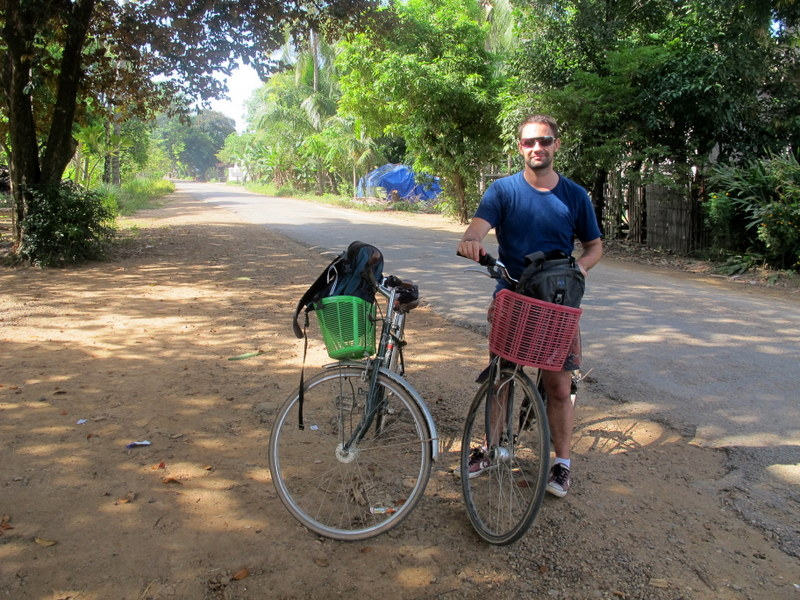 Husband and bicycles on the road in Kratie.
