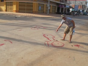 There was a minor road accident. The local law officer painted this on the road to indicate what had gone down.
