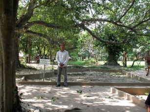 Guide standing by one of the mass graves.