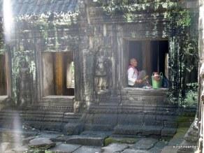 Monk taking a break from tending a shrine.
