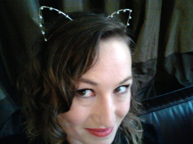 In pearl-studded cat ears at high tea