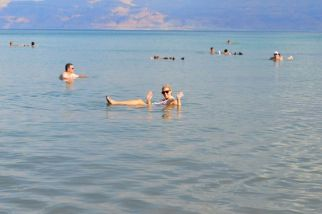 Kirst floating in the Dead Sea